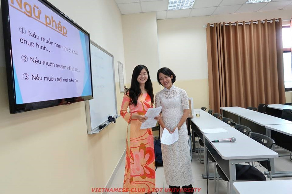 Two beautiful, graceful Japanese female students in Vietnamese 'Ao dai'